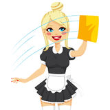 Blonde Maid Cleaning Window. Beautiful blonde woman in maid dress working cleaning window with yellow cloth Royalty Free Stock Photography