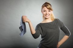 Blonde maid enjoying her work. Chores housework silly hygiene clean concept. Blonde maid enjoying her work. Young girl dancing waving around dirty rag cleaning Stock Photos