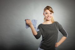 Blonde maid enjoying her work. Chores housework silly hygiene clean concept. Blonde maid enjoying her work. Young girl dancing waving around dirty rag cleaning Stock Image