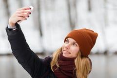 Blonde makes selfie in park stock photos
