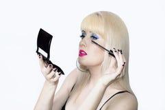 The blonde makes up eyelashes Royalty Free Stock Photo