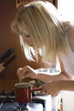 Blonde making coffee Royalty Free Stock Photography