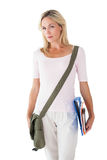 Blonde mature student carrying bag and books Stock Photos