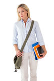 Blonde mature student carrying bag and books Stock Image