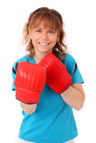 Blonde mature woman with boxing gloves punching Royalty Free Stock Photos