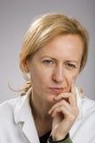 Blonde mature woman thinking Stock Photo