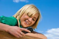Blonde messaging Stock Image