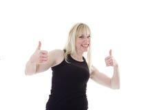 Blonde met twee omhoog duimen Stock Afbeelding