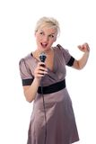 Blonde with mic Royalty Free Stock Photos