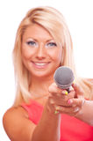 Blonde with microphone Royalty Free Stock Image
