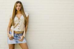 Blonde in mini skirt Stock Photography