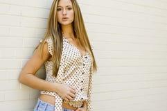 Blonde in mini skirt Royalty Free Stock Image