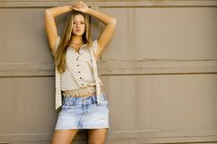 Blonde in mini skirt Royalty Free Stock Images