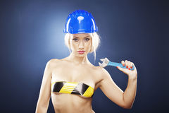 Blonde model with adjustable wrench Stock Photos