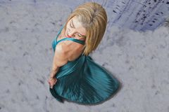 Blonde model. Attractive blonde female in blue dress royalty free stock photos
