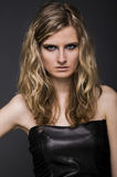 Blonde model with black leather top Royalty Free Stock Photos