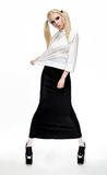 Blonde model in a black skirt and white blouse Stock Photography