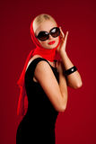 Blonde model with black sunglasses Royalty Free Stock Images