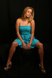 Blonde model in blue dress. Blonde model posing in blue dress and looking at camer Stock Images