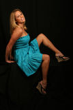 Blonde model in blue dress Royalty Free Stock Image