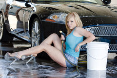 Blonde Model at the Car Wash Royalty Free Stock Photos