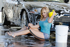 Blonde Model at the Car Wash Royalty Free Stock Photography