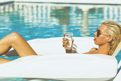 Blonde model chilling in a pool Stock Photo
