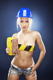 Blonde model with an electric sander. Royalty Free Stock Photos
