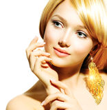 Blonde Model Girl. Beauty Blonde Fashion Model Girl With Golden Earrings royalty free stock images