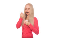 Blonde model are going to taste yogurt with spoon Royalty Free Stock Image