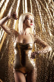Blonde model in gold Stock Photos