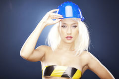 Blonde model with helmet Royalty Free Stock Image