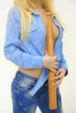 Blonde model holding a baseball bat stock photo