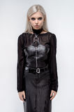 Blonde Model in modern leather outfit Royalty Free Stock Images