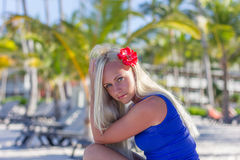 Blonde model on the palms trees background. Close up portrait stock image