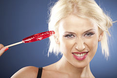 Blonde model plays with a lollipop. Stock Photo