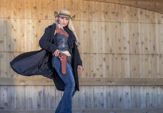 Blonde Cowgirl. A blonde model posing as a cowgirl in a western environment Royalty Free Stock Photo