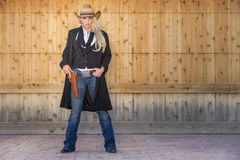 Blonde Cowgirl. A blonde model posing as a cowgirl in a western environment Royalty Free Stock Image
