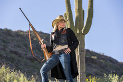 Blonde Cowgirl. A blonde model posing as a cowgirl in a western environment Royalty Free Stock Images