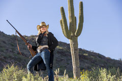 Blonde Cowgirl. A blonde model posing as a cowgirl in a western environment Stock Photo