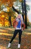 Blonde model posing - autumm season. Blonde model posing on the autumn background stock photography