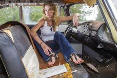 Blonde Model Posing With A Vintage Car Royalty Free Stock Photos