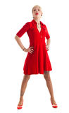Blonde model in a red dress Royalty Free Stock Image