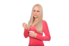 Blonde model in red are going to taste yogurt Royalty Free Stock Image
