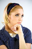 Blonde model thinking. Intense and looking up Royalty Free Stock Images