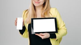 Blonde with moderns gadgets. Gadgets. with phone royalty free stock photography