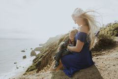 Blonde mom with her son outdoors royalty free stock photos