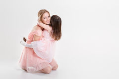 Blonde mom and sweet little daughter in pink dresses princesses Royalty Free Stock Photo