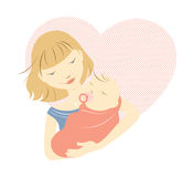 Blonde mother and baby. Blonde mother holding baby in front of a heart Stock Photos