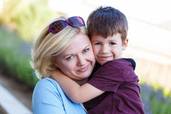 Blonde mother with young son Stock Photography